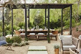 Outdoor Spaces Design - an outdoor space designed for dining and relaxing by the fire
