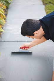 How To Repair A Patio by How To Resurface Worn Concrete Walkways Concrete And Yards