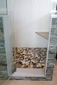modern bathrooms designs and remodeling htrenovations the river cobble tile stacked stone and textured tile in the shower really make a statement within this modern bathroom in north wales pa