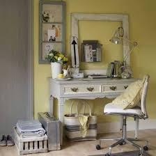 home office country style with yellown walls and vintage framed