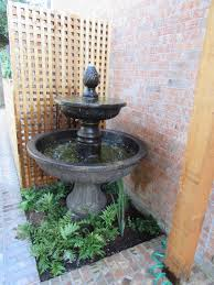 high function in a small side yard pergola raised bed mirrored