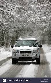land rover snow land rover freelander 2 four wheel drive vehicle driving along a