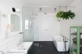 kohler archer tub with glass shower door white wainscoting alcove