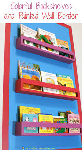 Colorful Bookcases Colorful Bookshelves And Painted Wall Border Wall Borders Walls