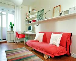 modern study room with red chair and sofa bed home design and
