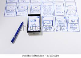 working desk sketches screens mobile application stock photo