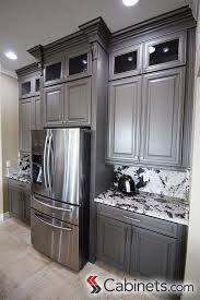 gray kitchen cabinets with white crown molding how they put glass inserts in their cabinets