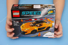 speed chions mclaren speed chions box with mclaren p1 in childs hands stock