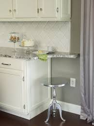 granite countertop espresso and white cabinets tile backsplash