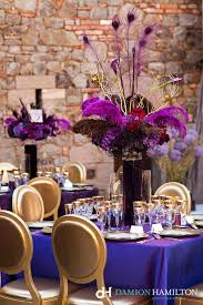Wedding Feathers Centerpieces by Gold And Purple Table Setting With Feathers In The Centerpiece