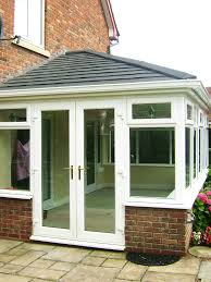 large tiled conservatory roof supalite with charcoal metrotiles