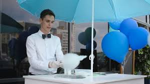 balloons for him cotton candy on a special machine it wears bow
