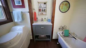 beautiful bathroom with clawfoot tub in this tiny heirloom for