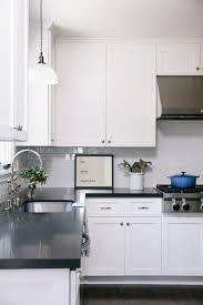 white kitchen cabinets with black quartz white kitchen cabinets with black counters transitional