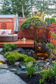 water feature creates focal point in backyard oasis modern home