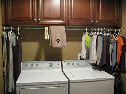 laundry room cabinets with hanging bar design and ideas