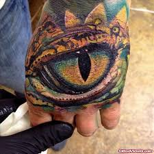 colored eye tattoo on left shoulder tattoo viewer com