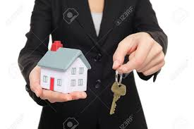 real estate agent new house keys concept realtor showing holding