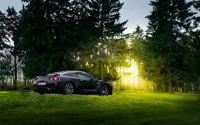 black nissan sports car nissan gtr r35 matte black japan sport car farm forest summer sun