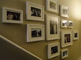 wedding frame collage along the stairs using ikea picture frames