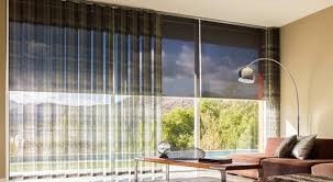 xl vertical blinds effortlessly cover wide walls of windows shown