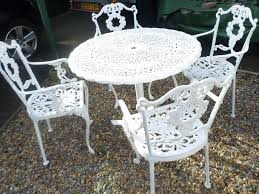 Vintage Cast Iron Patio Furniture - lovely old cast metal garden table and 4 chairs in christchurch