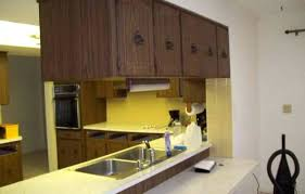 how do you hang kitchen cabinets installing kitchen cabinets in garage hanging from ceiling