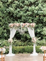 wedding ceremony arch wedding ceremony arch with draping fabric and chandelier