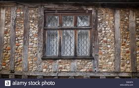 wood framed tudor style house flint walls lead windows little