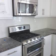 Kitchen Subway Tiles Backsplash Pictures by Incredible New Caledonia Granite Counter With White Subway Tile
