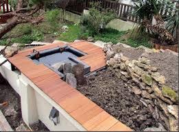 construire son jacuzzi construire un bassin hors sol avec déversoir dans une rocaille