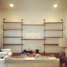 Tv Wall Shelves by White Corner To Corner Shelves And Cabinets In The Living Area