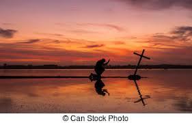 at prayer cross sunset a praying to a stock