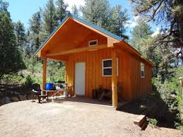 aesthetic one room hunting cabin with portable gas stove camping