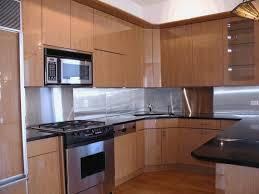 kitchen metal backsplash black tin backsplash smooth white countertop steel stovetop
