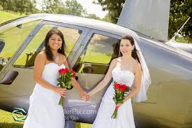 lgbt wedding dresses helicopter wedding portraits at falcon s golf steven