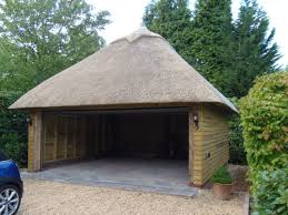 2 bay oak framed garage with a thatched roof