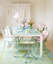 white dining table with glass top mint rug light wood flooring