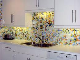 glass mosaic tile backsplash with white cabinets kitchen