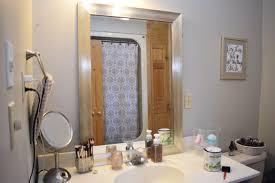 i bit the bullet and painted the bathroom mirror black u2013 breann