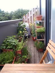 comfy small herb garden balcony with wooden patio folding chairs