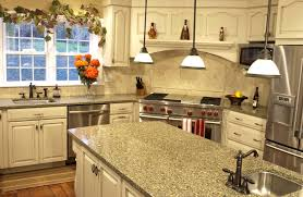 granite countertop brown and white kitchen cabinets black and