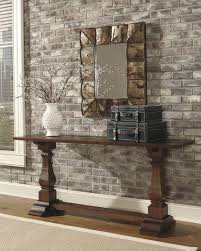 pottery barn living room with wicker coffee table and beige