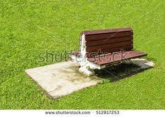 Benches In Park - bench in park with sunlight brown wooden chair seat green leave