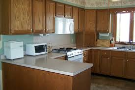 blue kitchens with brown cabinets awesome painting kitchen wood