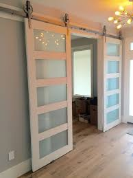 Erias Home Designs Top Of Door Sliding Barn Door Hardware by Solid Glass 3 Paneled Barn Door Barn Doors Barn And Doors