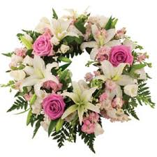 white lillies wreath with white lilies pink roses