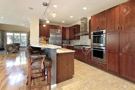 kitchen with island and breakfast bar kitchen in suburban townhouse with breakfast bar stock photo