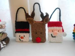crocheted christmas 18 patterns for crochet christmas gift bags boxes and pouches