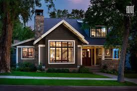 craftsman house exteriors single brown front door along gray tile